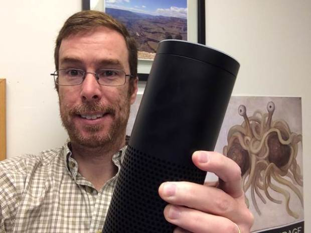 Geologist Dennis Keane with his Amazon Echo.