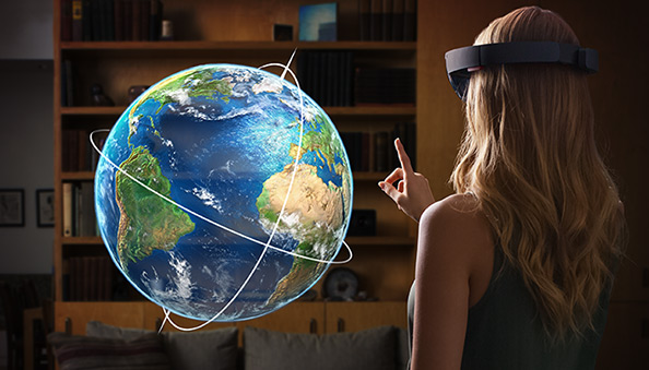Using Microsoft HoloLens to see and interact with a world globe.