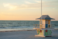 Beach lifeguard tower on a beach in Clearwater, Florida at sunset. Photo via Shutterstock