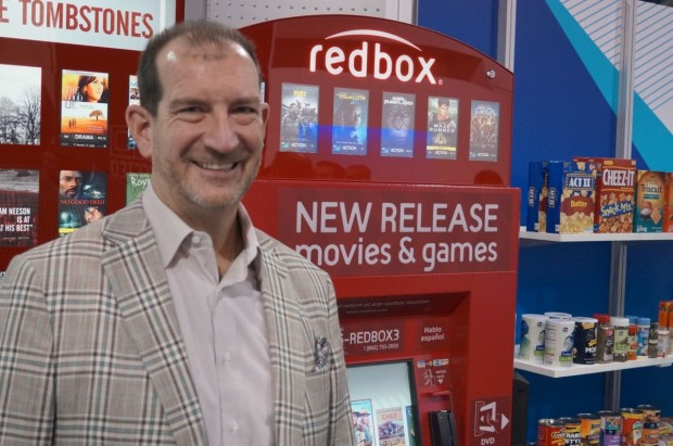 Scott Di Valerio, Outerwall CEO, at the Redbox kiosk