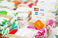 Etsy allows its sellers to accept payments in person using a mobile credit card reader.