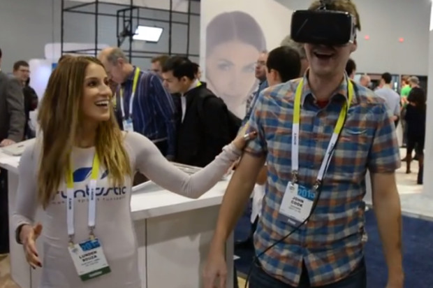 GeekWire's John Cook tries out an Oculus Rift virtual reality headset at CES 2015.