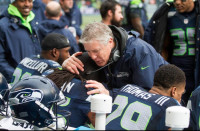 Coach Pete Carroll with Richard Sherman and Earl Thomas. Photo via the Seahawks.