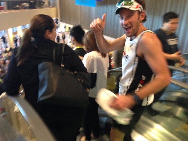 Tim Don on the escalator as he looks to complete his triathlon at CES.