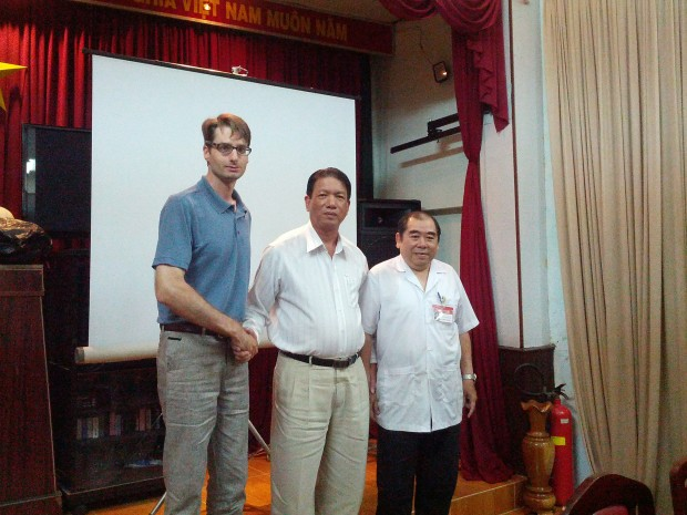 Markus with traditional medicine practitioners in Vietnam.