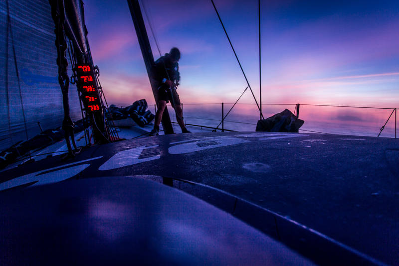 October 15, 2014. Leg 1 onboard Team Vestas Wind: Tom Johnson climbs the rig before the sunset to see if we still have a VHF aerial on the mast during day 4 of the Volvo Ocean Race.