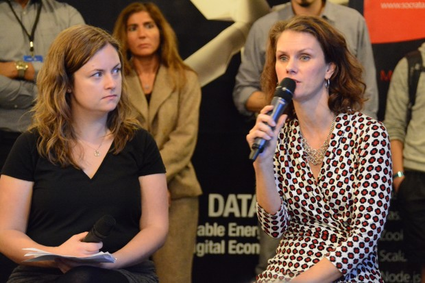 Lisa Wolters, right, speaks at Hack Housing on Friday.