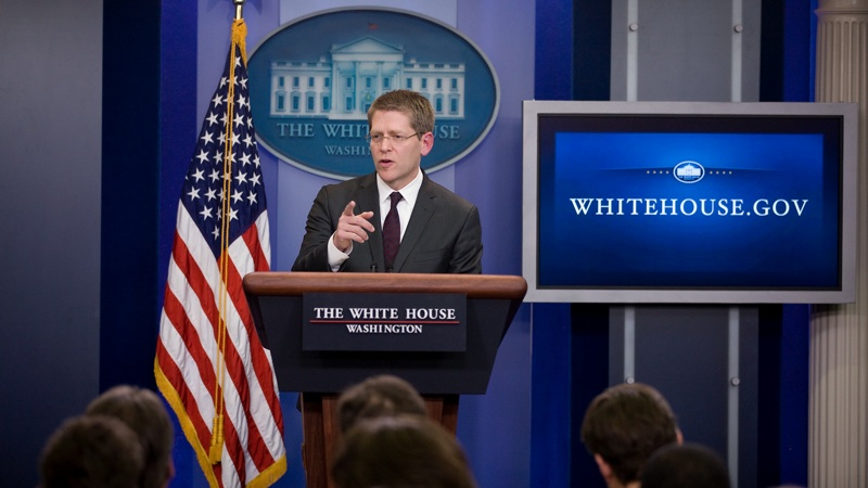 Jay Carney briefs the media  in 2011. (Official White House Photo by Lawrence Jackson)