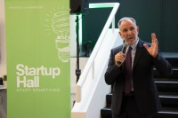 Outgoing University of Washington President Michael Young speaks at the UW Startup Hall launch event. Photo via UW.