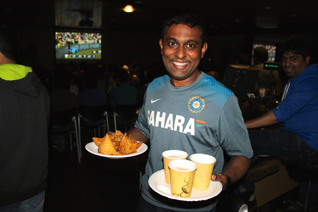 Dhigha Sekaran, an engineering manager at Microsoft, with fresh samosas and hot chai tea at the cricket watch party.