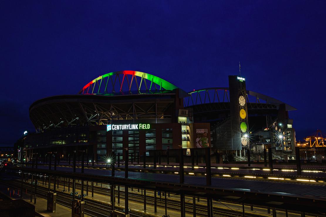 centurylink field lights up for paul allen u2019s tackle ebola