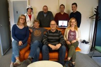 Front: Tricia Duryee, John Cook, Todd Bishopm Monica Nickelsburg. Back: Molly Brown (getting ready to jump on her bike), Daniel Rossi, Adam Rubens, Taylor Soper, and Blair Frank on video chat.