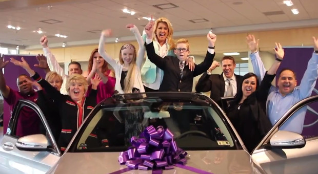 Solavei Presidential Director Staci Wallace, center, celebrates the keys to her new Mercedes.