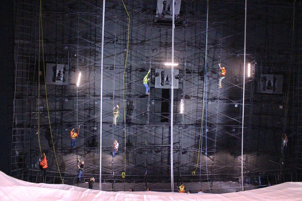 Workers climb a scaffolding to help raise the new IMAX screen at Pacific Science Center.