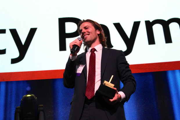 Dan Price accepts the Young Entrepreneur of the Year Award at the GeekWire Awards in 2013.