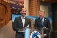 Expedia CEO Dara Khosrowshahi (left) and Seattle Mayor Ed Murray (right) hold a press event to announce the company's move.