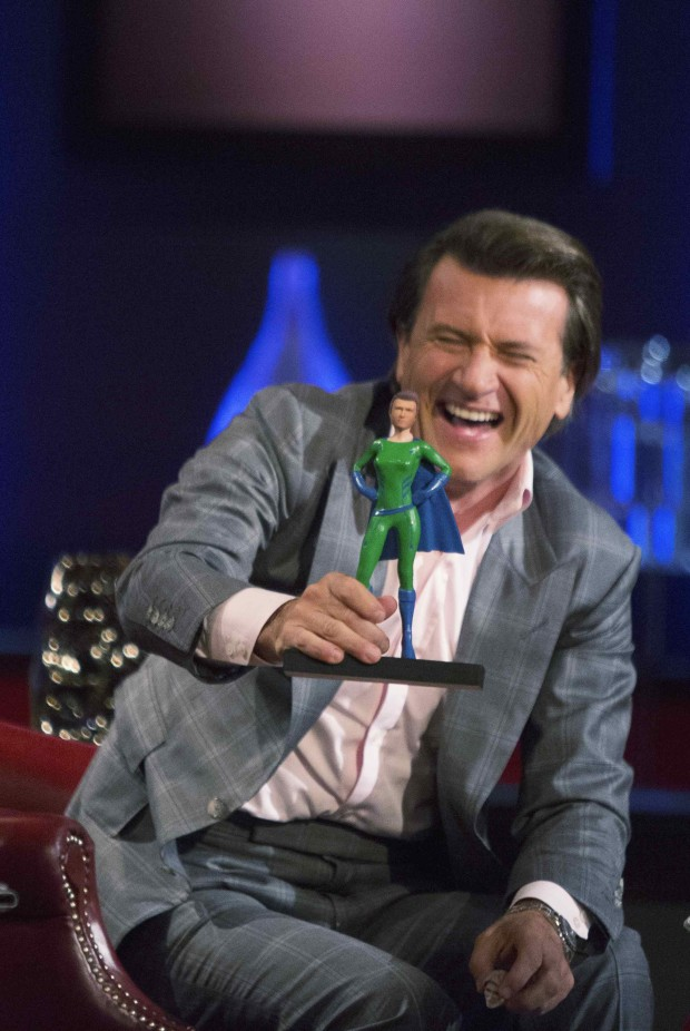 Robert Herjavec gets his You Kick Ass action figure/ Photo credit: Shark Tank/©Michael Desmond/ABC