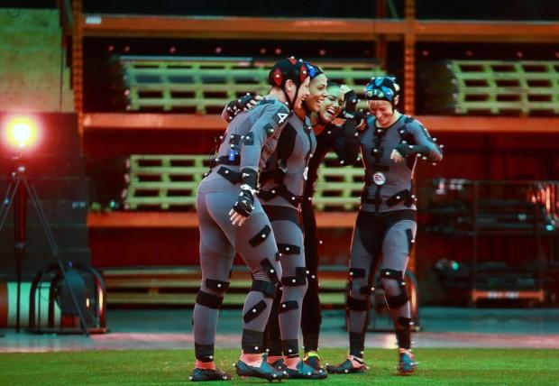 Professional soccer players assist animators with motion-capture suits. Photos via Pixelkin