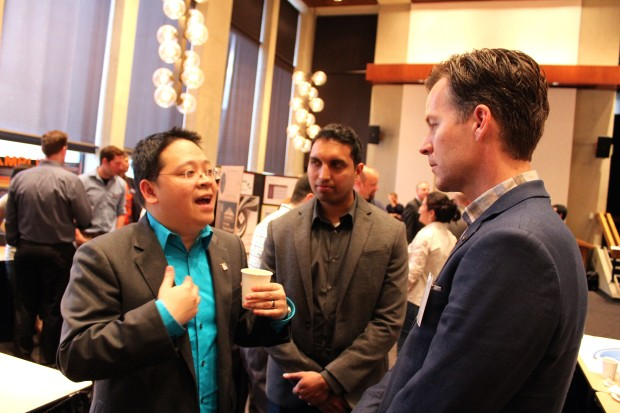 Vulcan Capital Managing Director Steve Hall hears a pitch from a University of Washington MBA student on Friday.