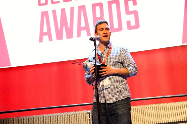 Utrip CEO Gilad Berenstein accepts the award for Young Entrepreneur of the Year at the GeekWire Awards 2015.