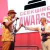 Avalara CEO Scott McFarlane celebrates with founder Rory Rawlings as he takes home the CEO of the Year award at the 2015 GeekWire Awards