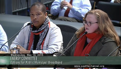 Upgrade Seattle members Karen Toering, left, and Sabrina Roach speak at Wednesday's Energy Committee meeting.