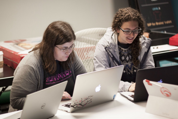 Jennifer Owens and Jessica Perrin work on the coding project at a Code Carrots workshop in Seattle.