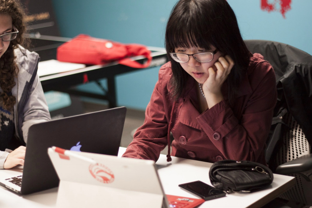 Lucy Liang is one of the mentors during the Code Carrots workshop that assists new coders in developing their project.