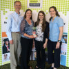 UW CSE's Ed Lazowska, Crystal Eney, Allison Obourn, and Ruth Anderson with the NCWIT NEXT Award Grand Prize trophy. Photo via UW.