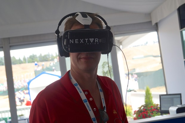 My colleague John Cook watches live golf with a virtual reality headset at the U.S. Open.