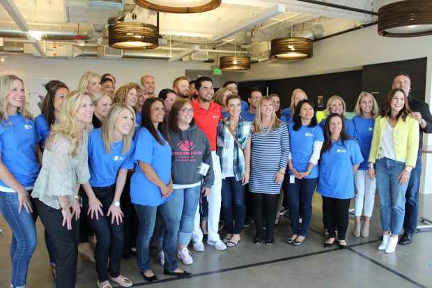 Jason Day poses with Concur employees after visiting the company in June to help stuff backpacks with food to benefit the Boys and Girls Clubs of King County.