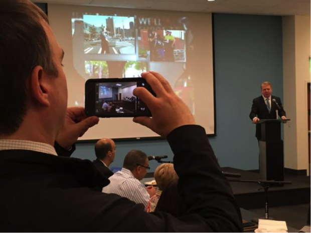 Mayor Ed Murray launches the workshop as Seattle Police spokesman Sean Whitcomb snaps his picture. (Photo by Bill Schrier.)