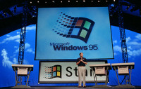 Bill Gates introduces Windows 95 during a launch event in August 1995.