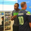 "Baldwin poses with a Seahawks fan who customized a jersey with ""Windows 10"" on the back."