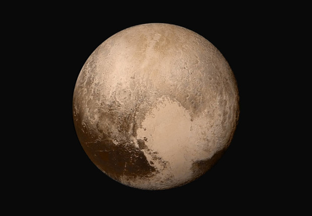 Pluto. Photo via NASA/JHUAPL/SwRI