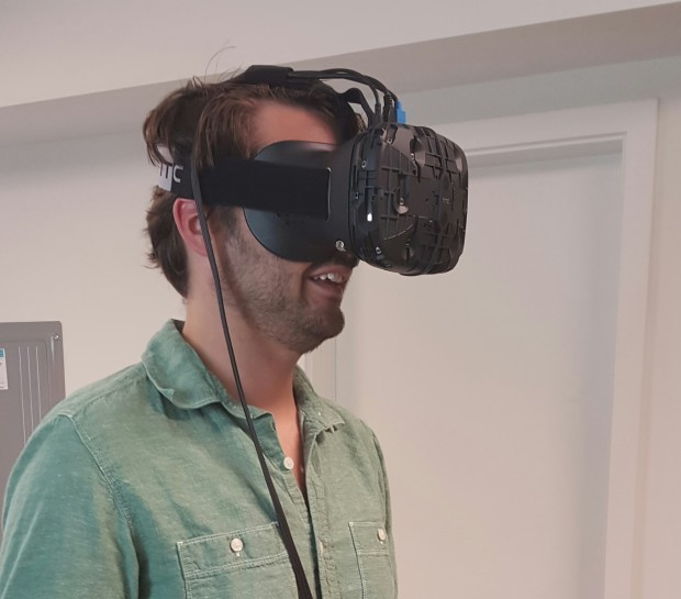 GeekWire's Jacob Demmitt tries out a virtual reality headset at Endeavor One's headquarters.
