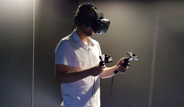GeekWire reporter Jacob Demmitt tries out the HTC Vive.