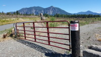 A red gate blocks the road leading to where Snoqualmie locals say Amazon is testing drones.