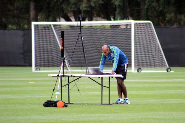 Ravi Ramineni analyzes wearable tracking data at a Sounders practice last month.
