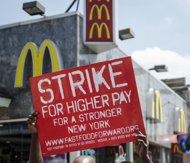 Photo via Wikipedia/NYC worker strike over minimum wage law in 2013