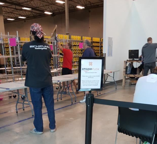 Inside an Amazon Flex package pickup facility in Kirkland, Wash. (GeekWire Photo, Jacob Demmitt)