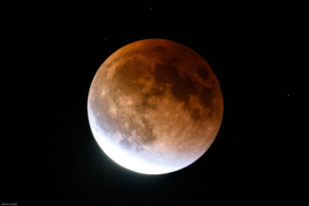 A total lunar eclipse gives the full moon a reddish tinge in 2015