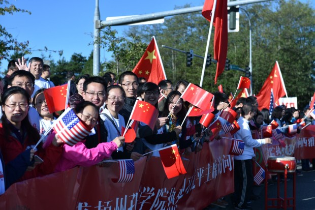Chinese supporters gather at Paine Field in Everett as China President Xi Jinping arrives.