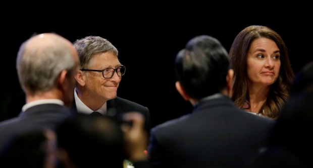 Microsoft Corp. founder Bill Gates,left, and his wife Melinda, right, sit with guests during a banquet for Chinese President Xi Jinping. Pool Photo, AP