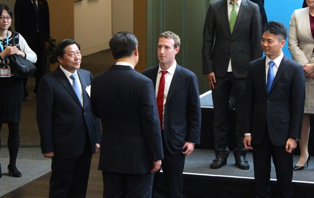 "Facebook CEO Mark Zuckerberg delivers a short message in Chinese to President Xi as China's ""Internet czar"" Lu Wei looks on at Microsoft's headquarters in September."