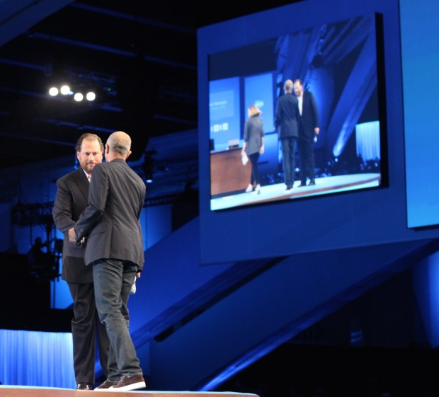 Salesforce CEO Marc Benioff and Microsoft CEO Satya Nadella shake hands on stage at the Dreamforce conference.