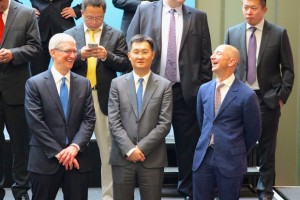Apple's Tim Cook and Amazon's Jeff Bezos during a gathering of tech execs at Microsoft to greet Chinese President Xi Jinping this week.