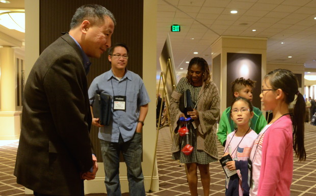 Girls who launched spacecraft last month meet astronaut Ed Lu at the GeekWire Summit