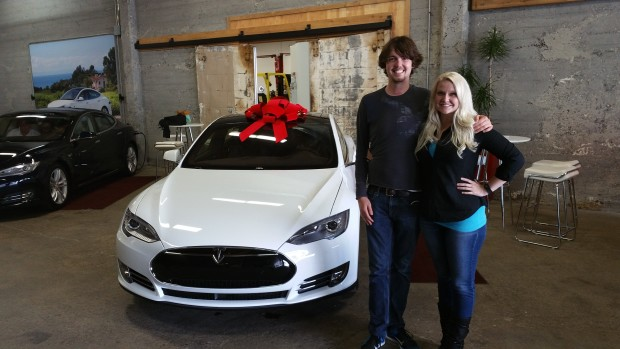 Jon Hall and his wife after receiving his Tesla. Photo via Jon Hall.