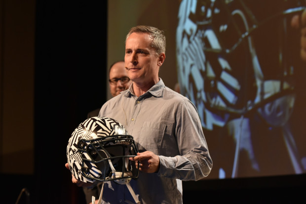 Vicis CEO Dave Marver shows off his company's high-tech football helmet at the GeekWire Summit in October.